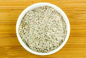 stock photo of porridge  - Aerial of healthy chia seed porridge in bowl on wooden background - JPG