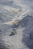 stock photo of dozer  - Loading and export of iron ore in career by open way by means of dredges and lorries - JPG