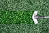 picture of sweeper  - Blue vacuum cleaner stand in green carpet at living room - JPG