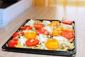 image of flabby  - Raw chiken on baking tray with tomato and potato - JPG