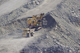 image of open-pit mine  - Loading and export of iron ore in career by open way by means of dredges and lorries - JPG