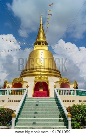 Gold pagoda with tree and sky background