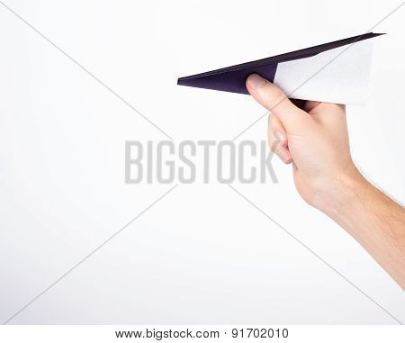 male hand holding paper airplane isolated on white