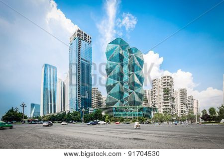 Chengdu,China-July 23,2014:modern buildings and empty road in chengdu.It's the epitome of fast development in southwest china.