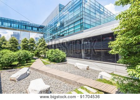 Chengdu,China-July 23,2014:modern building and green footpath in chengdu..It's the epitome of fast development in southwest china.