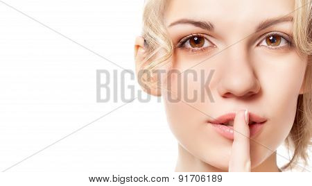 Young woman with a finger near her lips