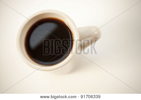 White Cup Full Of Black Coffee Stands On The Table