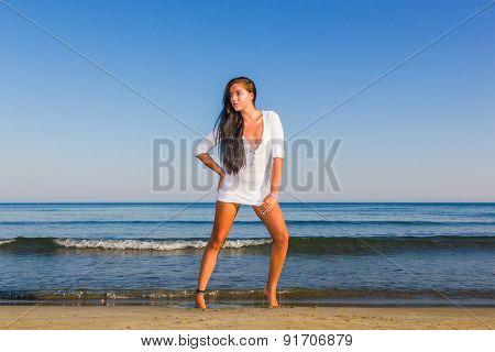 young beautiful woman on the beach in Bali Indonesia