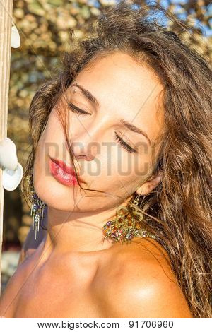 Beautiful young woman at the summer lounge
