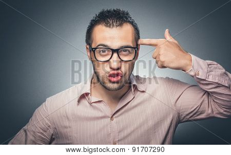 Man making funny gesture with finger gun