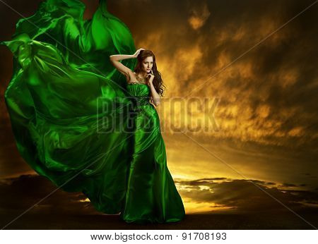 Woman Fashion Dress Fluttering Wind, Elegant Girl Portrait, Model Posing Green Silk Gown