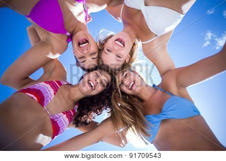 Beautiful women standing in circle at the beach