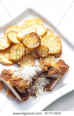 fried Parmesan pork fillet with Parmesan potatoes