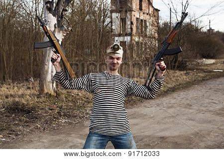Dressed In Sailor Shirt Man Holds Two Guns In His Hands