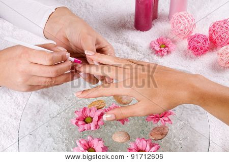 Manicure In The Spa Salon. Drawing Of Red Nail Polish. Spa Manicure, Nail Care. Girl Does A Manicure
