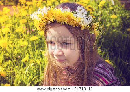 Girl with chaplet on head in the garden