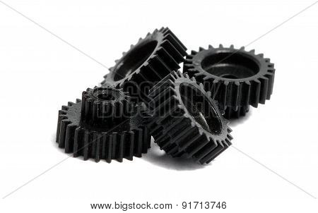 Several Small Gears Photographed Close Up On A White Background