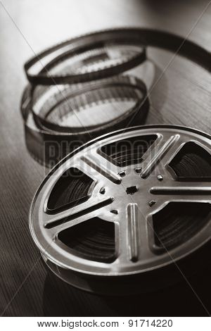Motion picture film reel on the table