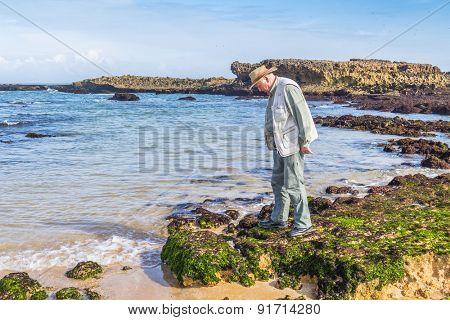 Senior tourist visiting beach in Oualidia, Atlantic coast of Morocco