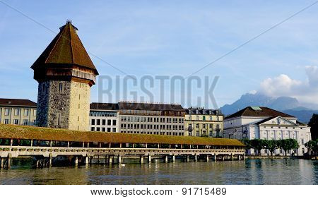 Wooden Chapel Bridge And Tower In Lucerne