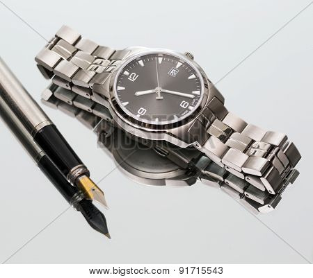 Wrist Watch. Pen. Close