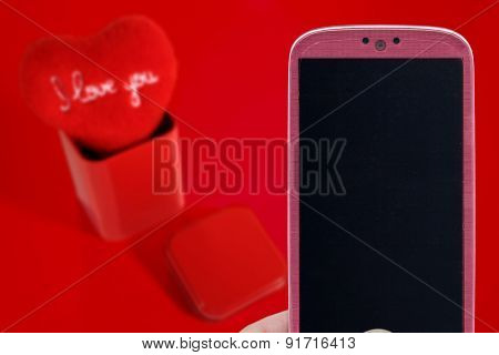 Pink smatrphone and I love you heart on red background. Idea for Valentines Day celebration, love, Father's or Mother's day, love apps, Internet, blogs and others.