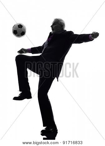 One Caucasian Senior Business Man playing soccer Silhouette White Background