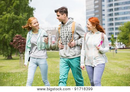 Young friends walking at college campus