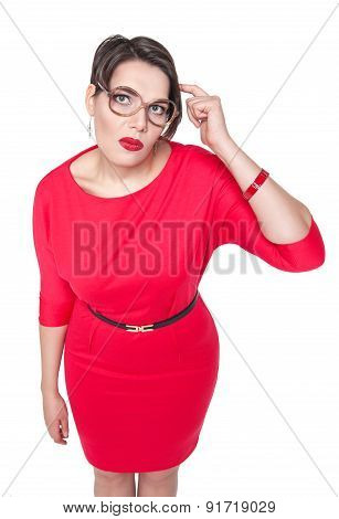 Plus Size Woman In Glasses Gesturing Finger Against Her Temple