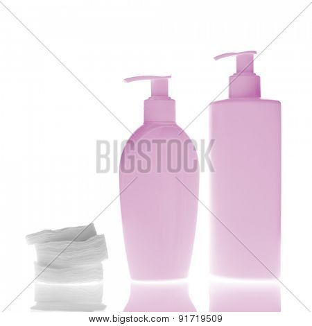set of cosmetic bottles with cleaning pads isolated on white background