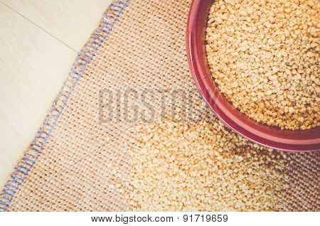 Couscous Grains In A Brown Porcelain Bowl