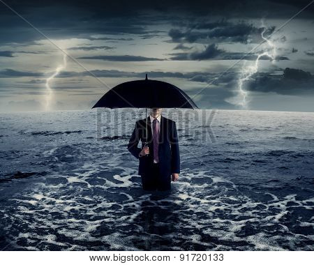 Business Man Holding Umbrella On The Sea