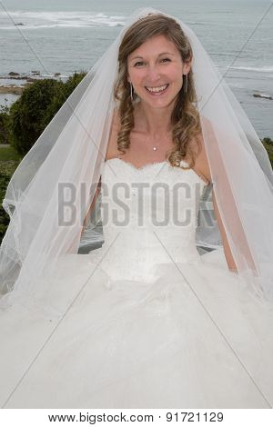 Portrait Of A Blond Bride At The Ocean