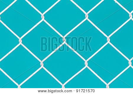 White Wire Fence On Green Background