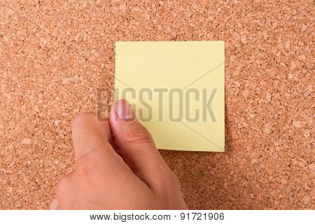 Hand And Sticky Post It Note