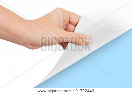 Hand Turning Page To Blue