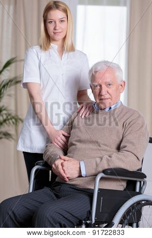 Caregiver And Disabled Man