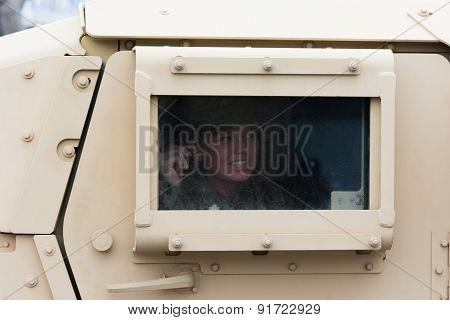 HMMWV Military vehicle with soldier looking out the window