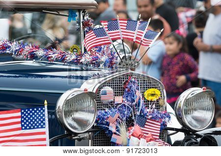 Vintage Car Decorated With American Flags