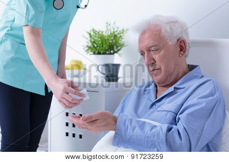 Nurse Giving Pills