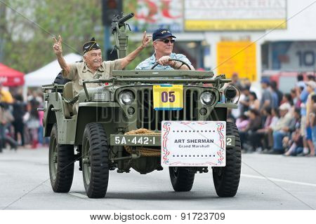 Us Veterans In Military Vehicle