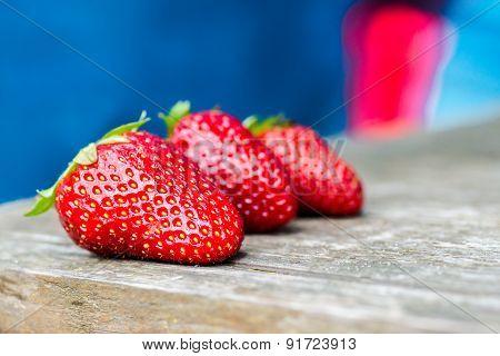 Fresh strawberries on a wood background