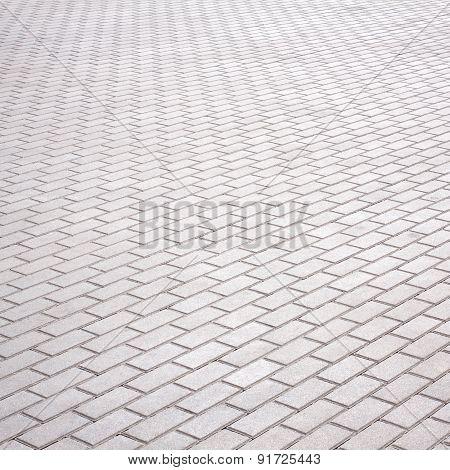 Gray brick stone street road. Light sidewalk, pavement or wall texture