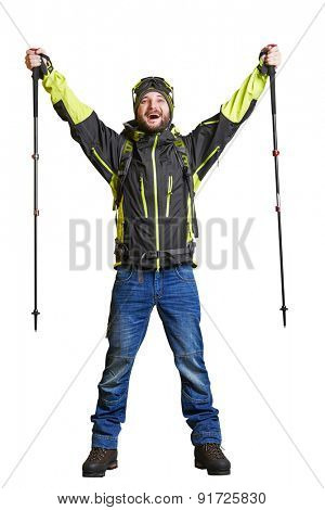 full length portrait of happy hiker with backpack and hiking poles raising his hands up and screaming. isolated on white background