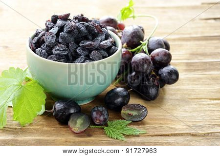 Natural organic dried grapes raisins, rustic still life