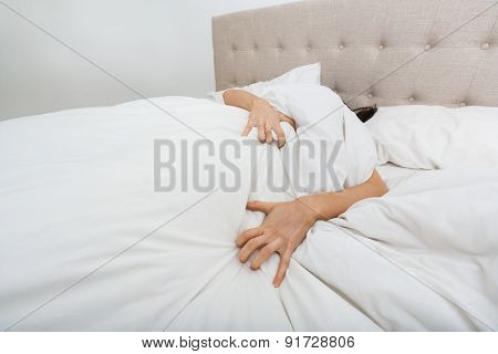 Sacred woman lying in bed