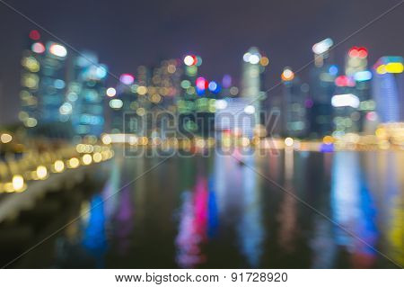 Night lights blur bokeh of city office building