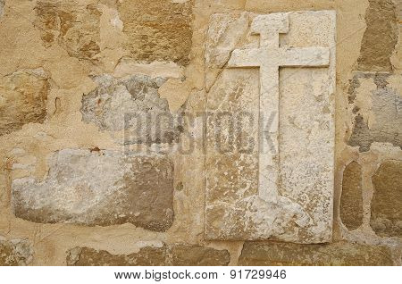 Cross on wall of a medieval church