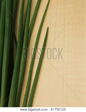 Wooden Background With Onion Leaves