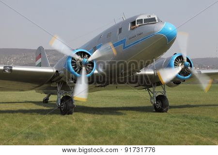BUDAORS, HUNGARY - APRIL 27: Li-2 aircraft starting engines on 27th April, 2014. This aircraft is 65 years old.